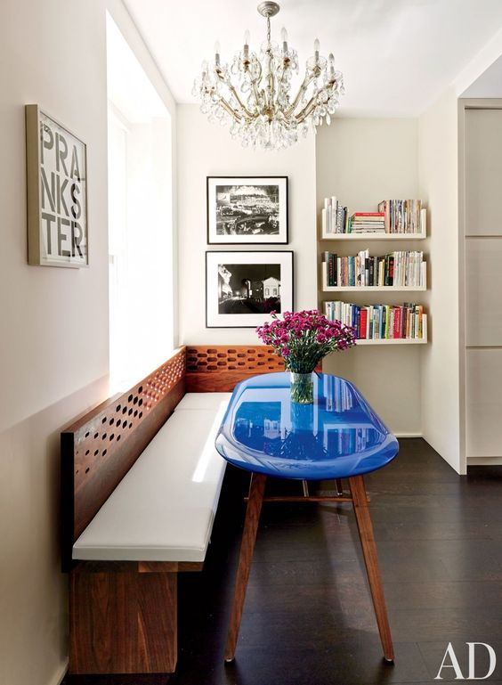 Glossy bright blue surfboard dining table with wood banquette in breakfast room - found on Hello Lovely Studio