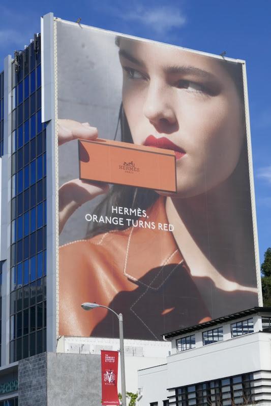 Giant Hermes Beauty Orange turns red billboard