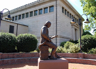 Ben Franklin reading outside the Franklin Public Library