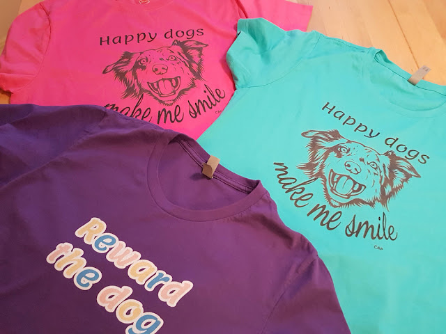 Companion Animal Psychology merch - 3 bright tees pictured in blue, pink, and purple. More in Companion Animal Psychology news