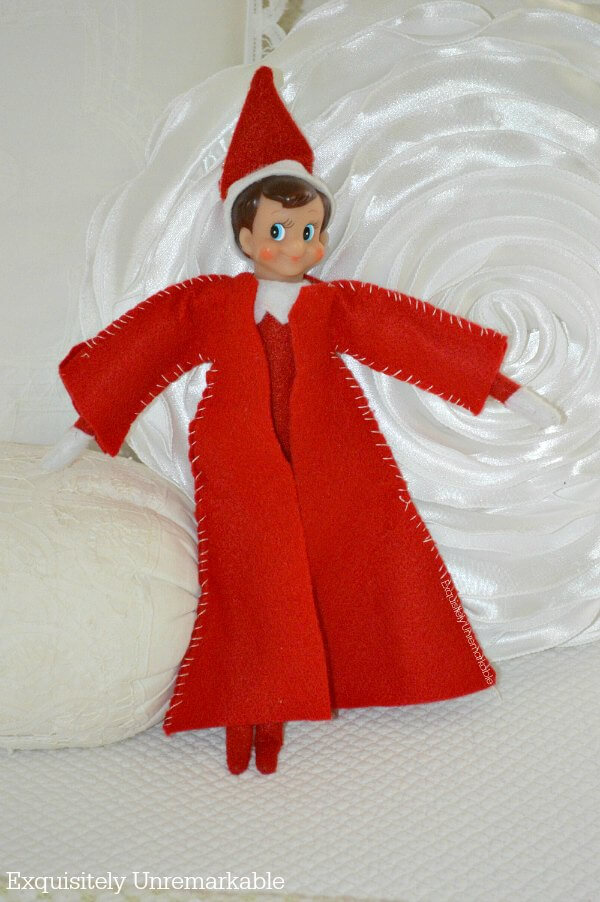 Elf On The Shelf Wearing a red felt coat