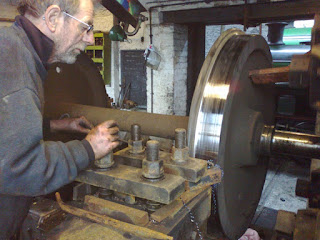Ian turning the tyre in the wheel lathe