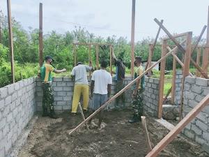 Satgas Yonarmed 9 Kostrad Melaksanakan Karya Bakti di Desa Tiowor