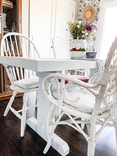 white mixed dining room chairs with farmhouse table