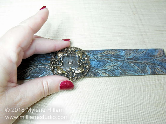 Centering the filigree on the leather strip