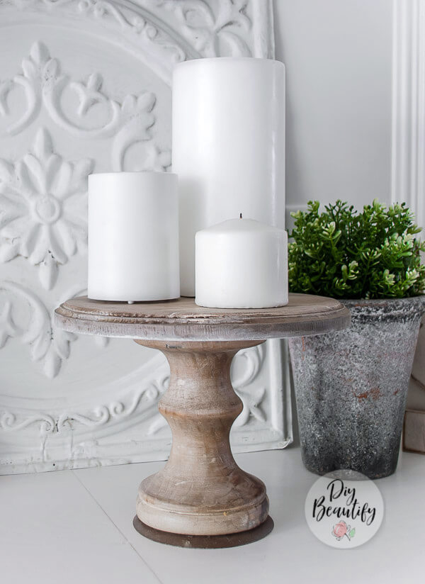 wood pedestal with candles