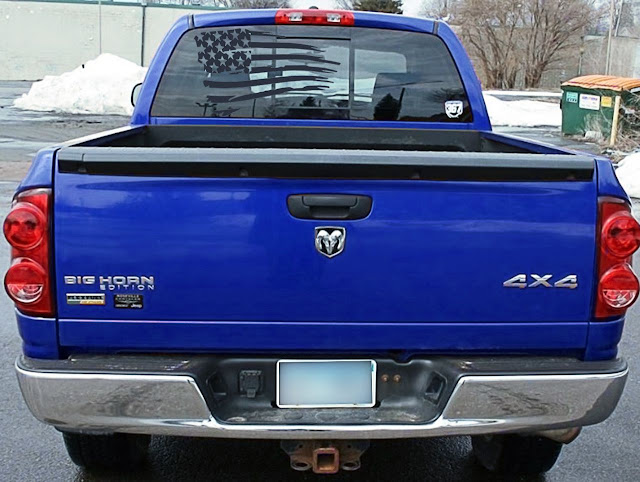 Black-American-flag-window-decal-on-blue-ram-1500-4x4-long-horn