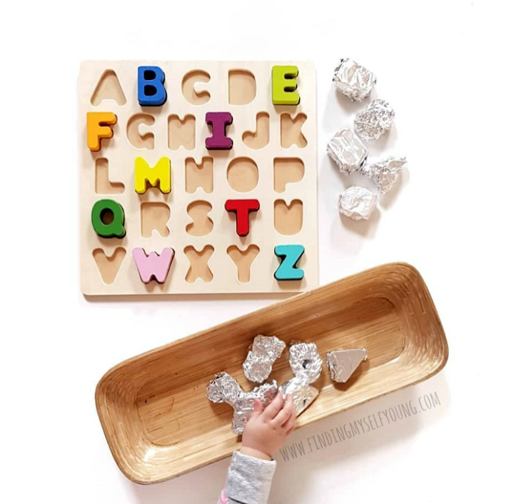 aluminium foil wrapped puzzle invitation to play