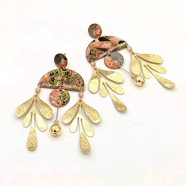 pair of brass and patterned origami paper statement earrings