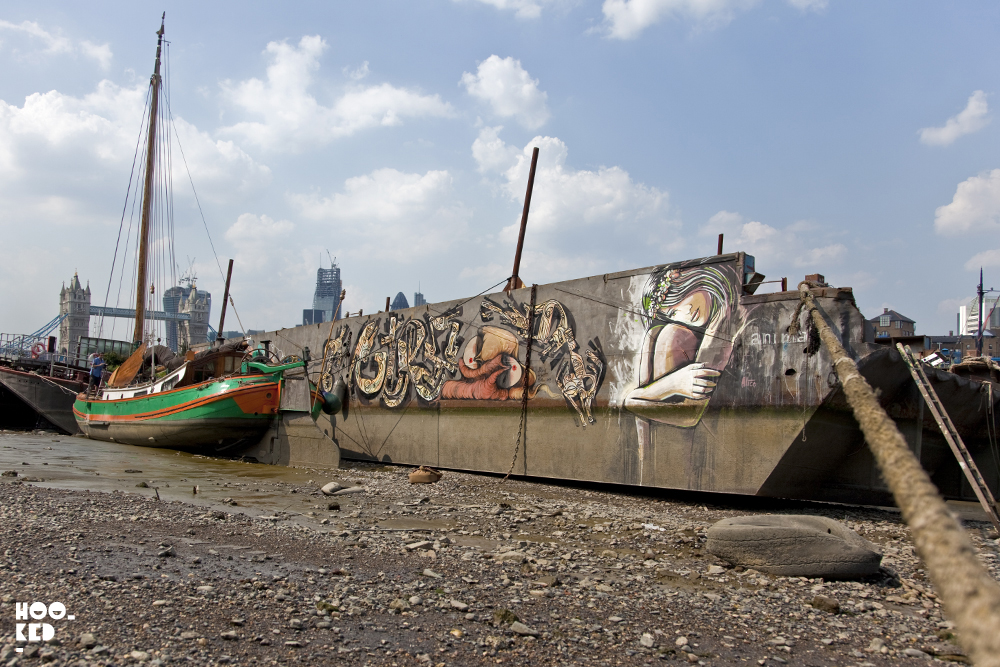 London Street art on a boat at Tower Bridge in London