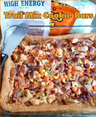 Trail Mix Cookie Bars, crunchy gooey trail mix snack bars baked in a cookie dough crust. | Recipe developed by www.BakingInATornado.com | #recipe #snack