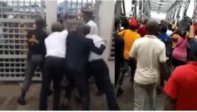 Hundreds Of Lagosians Shun Social Distancing, Struggle To Get Into A Bank (Video)