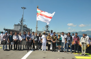 Vietnamese media with Rear Admiral S V Bhokare Onboard INS Satpura – JMSDF Warship Uraga is seen in the background