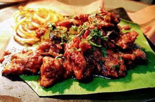Serving garnished chicken ghee roast for chicken ghee roast recipe