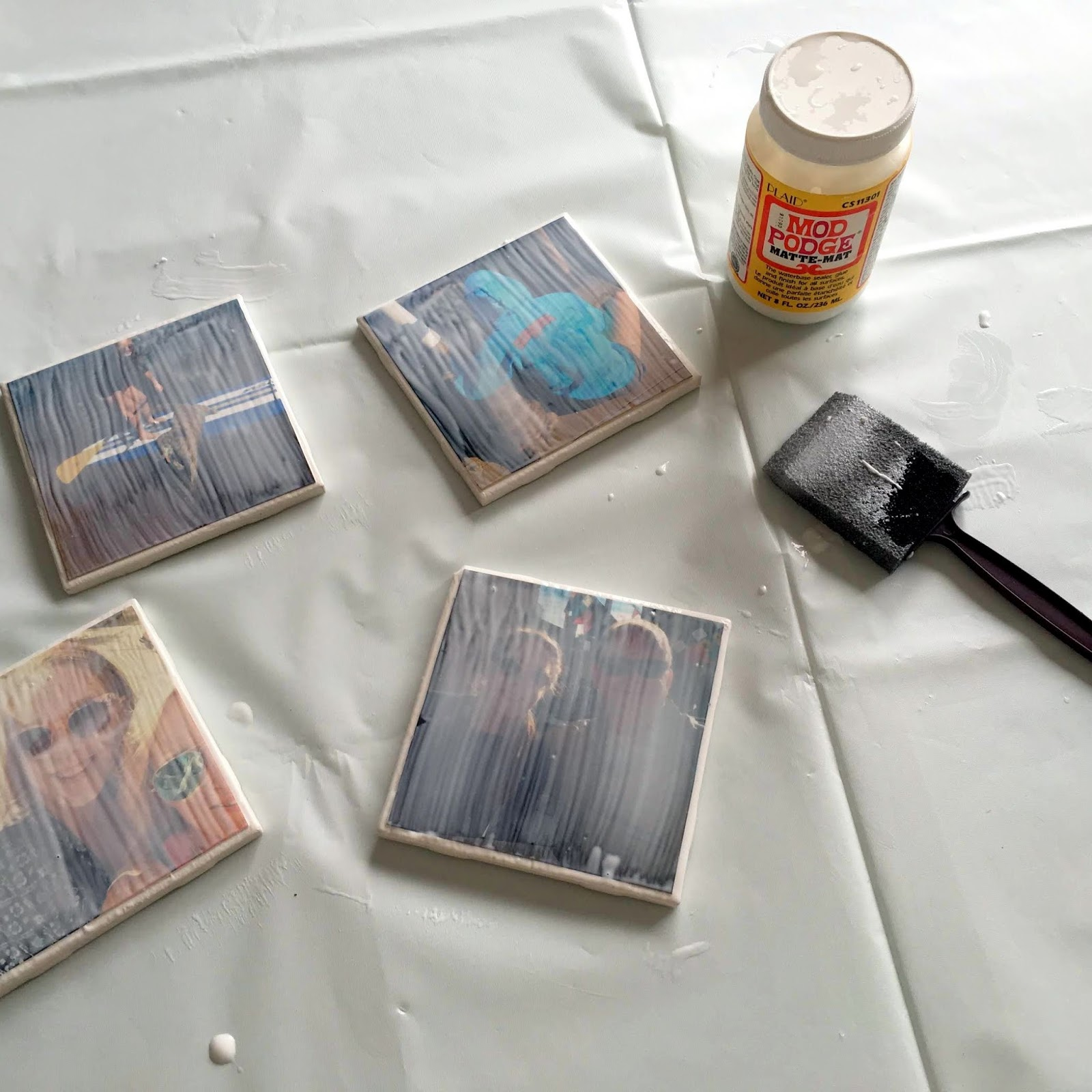 Personalize your coasters! All you need are photos, Mod Podge and ceramic tiles!