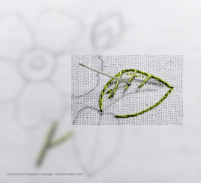 Beginning the first row of a needlepainted leaf
