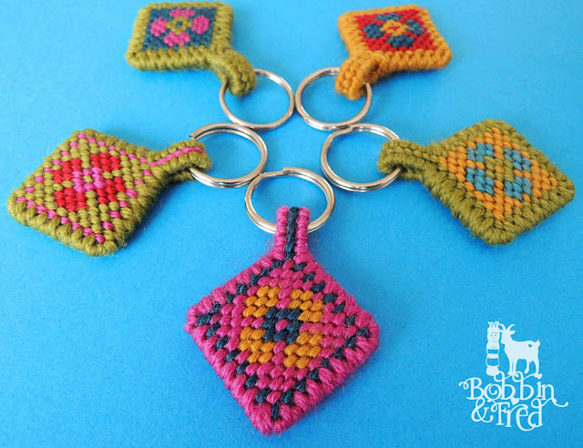 Five needlepoint tapestry keyrings with flower motifs