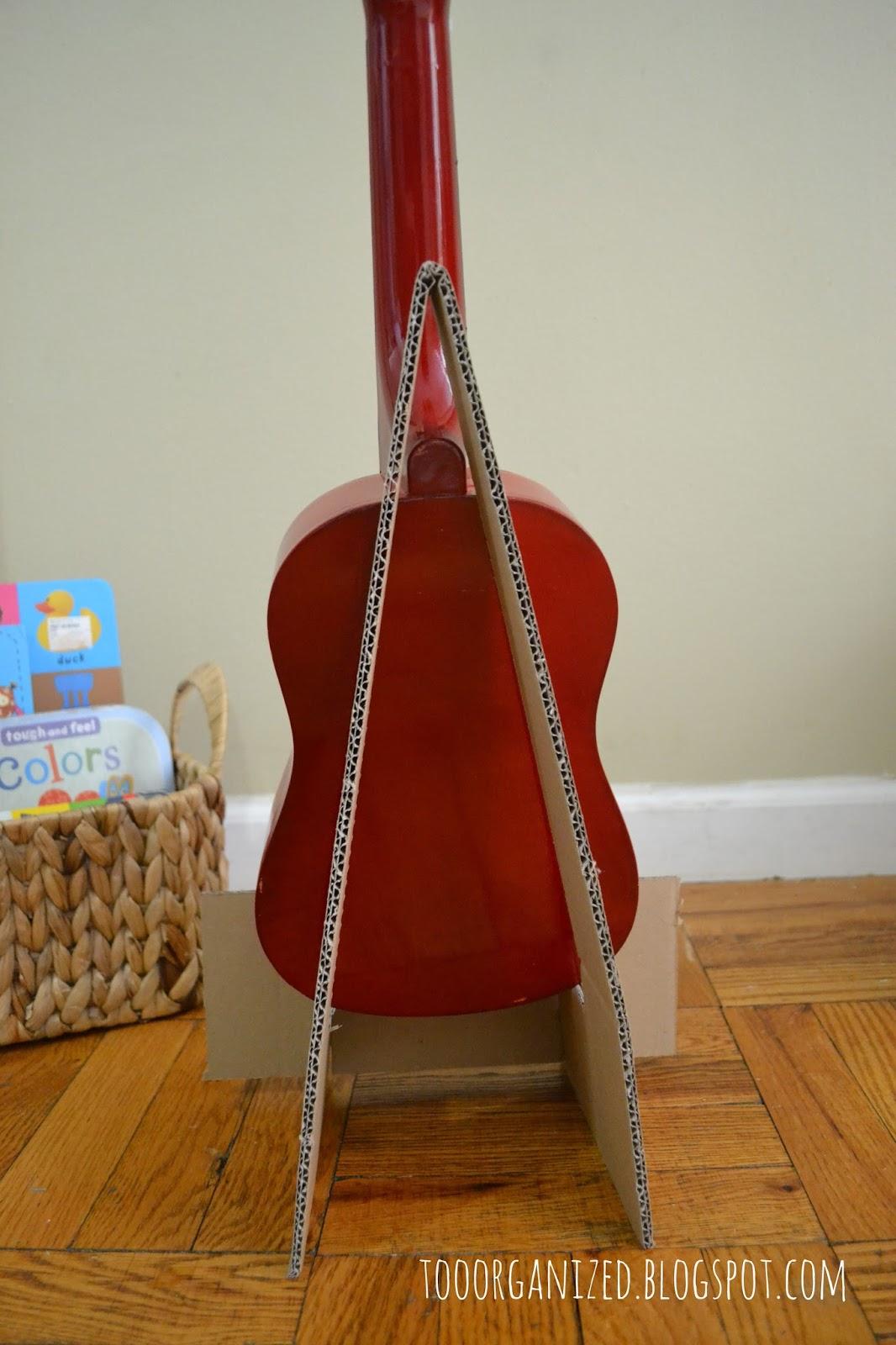 diy cardboard guitar stand too organized. Black Bedroom Furniture Sets. Home Design Ideas