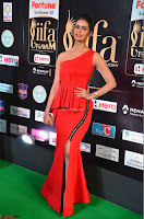 Meenakshi Dixit in Red One Shoulder Red Zipped up gown at IIFA Utsavam Award 14.JPG