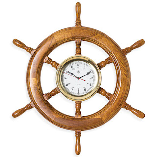 https://bellclocks.com/collections/bey-berk-international/products/oak-ships-wheel-brass-clock-bey-berk-sq514