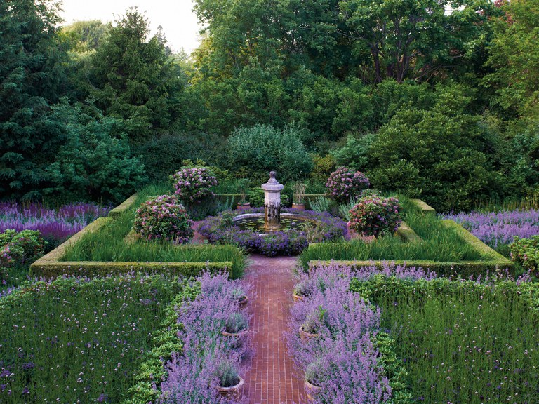 Gorgeous lush garden with lavender in Hamptons garden of Peter Marino