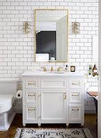 White bathroom vanity for unique bathroom decor with many brass details