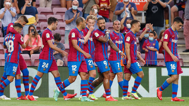 Barcelona players celebrate goal against Real Sociedad