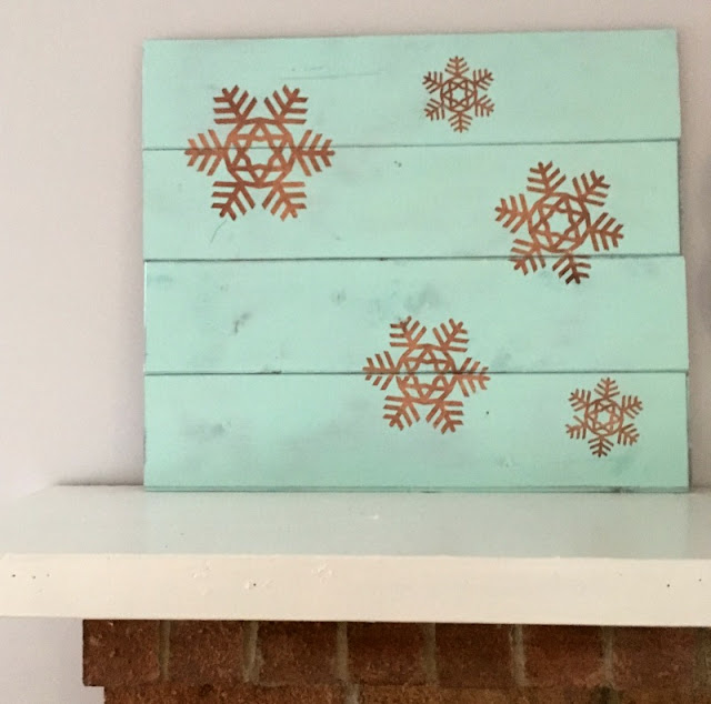 I used scrap wood, paint, and vinyl to make a Rustic Wooden Snowflake Sign.