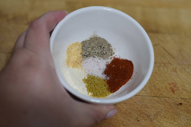 The spices used for the mushroom philly in a small dish.