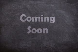 "On the background of a chalkboard, typed text reads ""Coming Soon"""