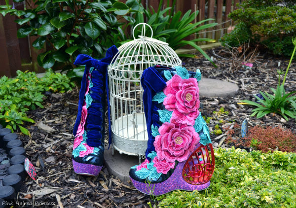 Irregular Choice boots with birdcage heel and birdcage in garden