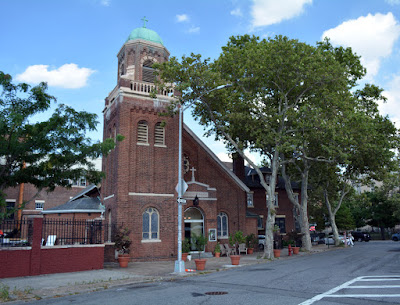 Red brick church facade facing southeast