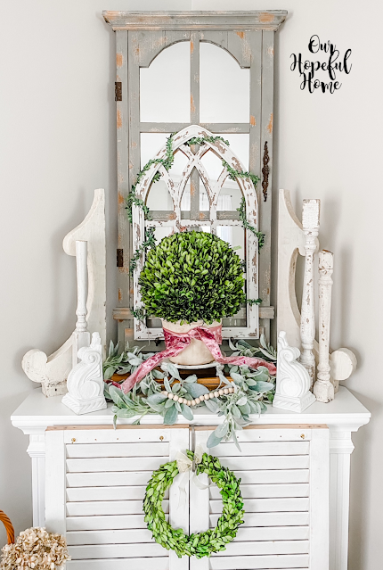 white shutters corbels balusters boxwood ball wreath