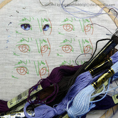 Royal School of Needlework Pet Portrait: First attempt at embroidering cat's eyes (in blue)