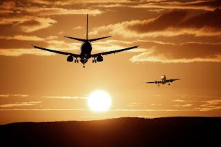 two planes flying in sunrise orange skye