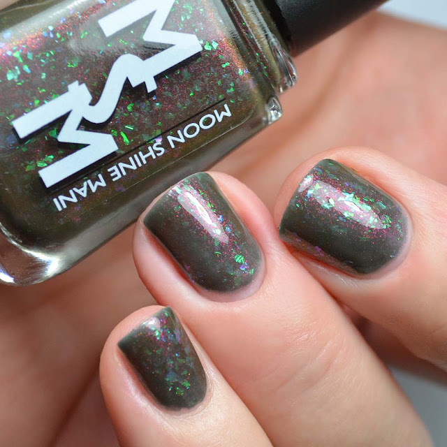 navy nail polish with shimmer and glitter swatch