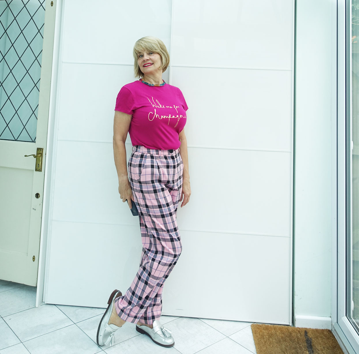 Pink check trousers and cerise tee with silver loafers worn by over-50s blogger Gail Hanlon from Is This Mutton