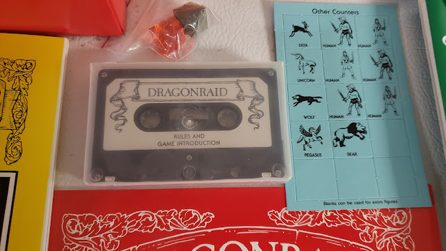 The DragonRaid RPG Box contents 6, and honest to goodness cassette tape!