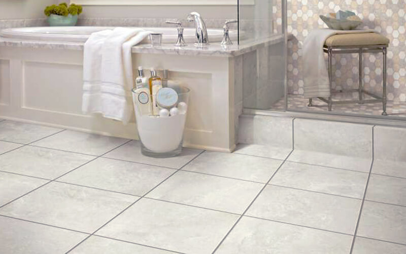 Bathroom with sandy-white flooring