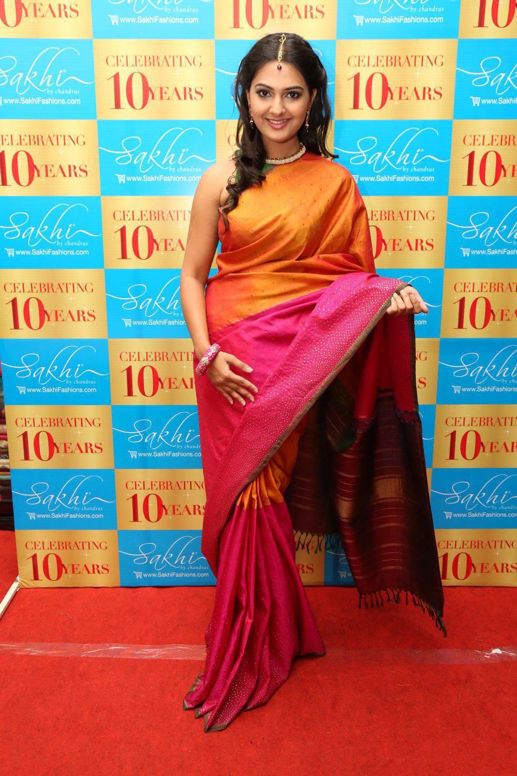 South Indian Actress Neha Deshpande Hip Navel In Traditional Orange Saree