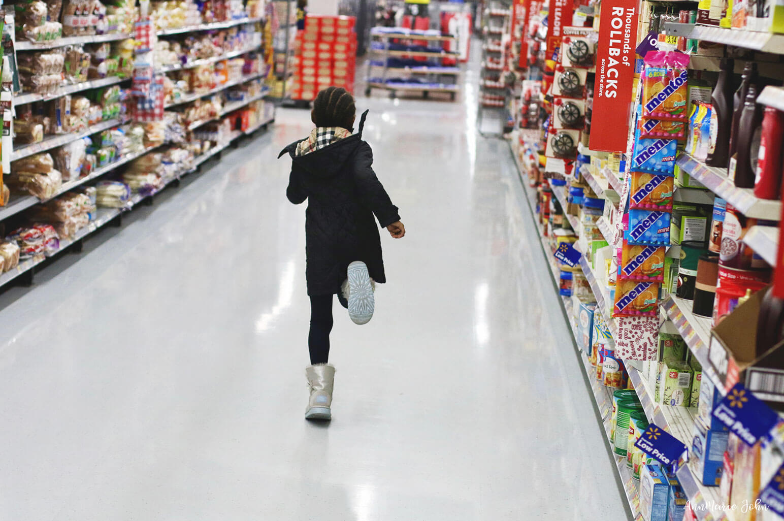 Child running through grocery store