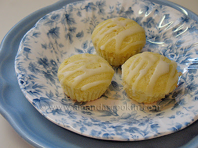 A close up photo of three German mini lemon cakes in a blue and white dish.