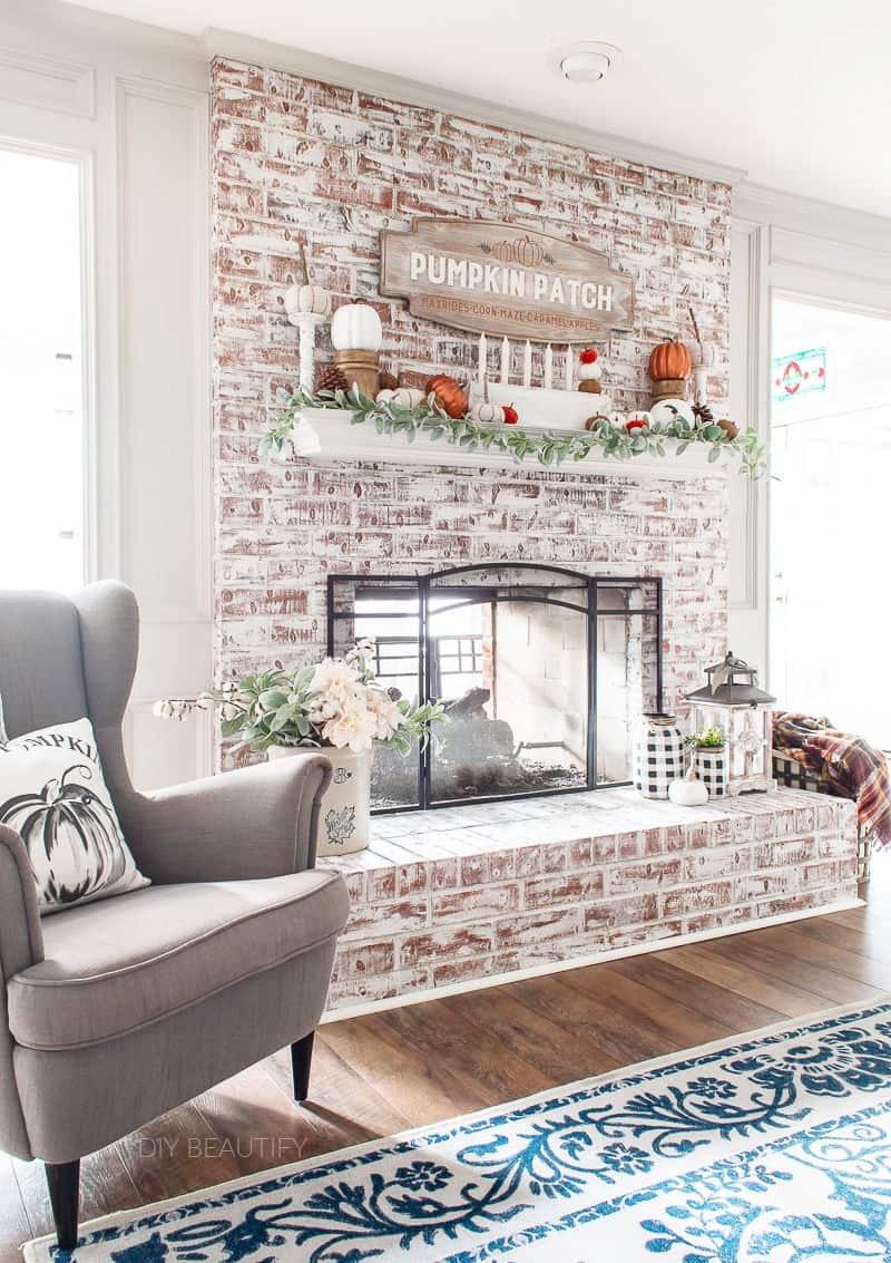 whitewash fireplace and fall mantel