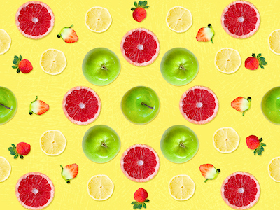 Fruits top view on yellow background