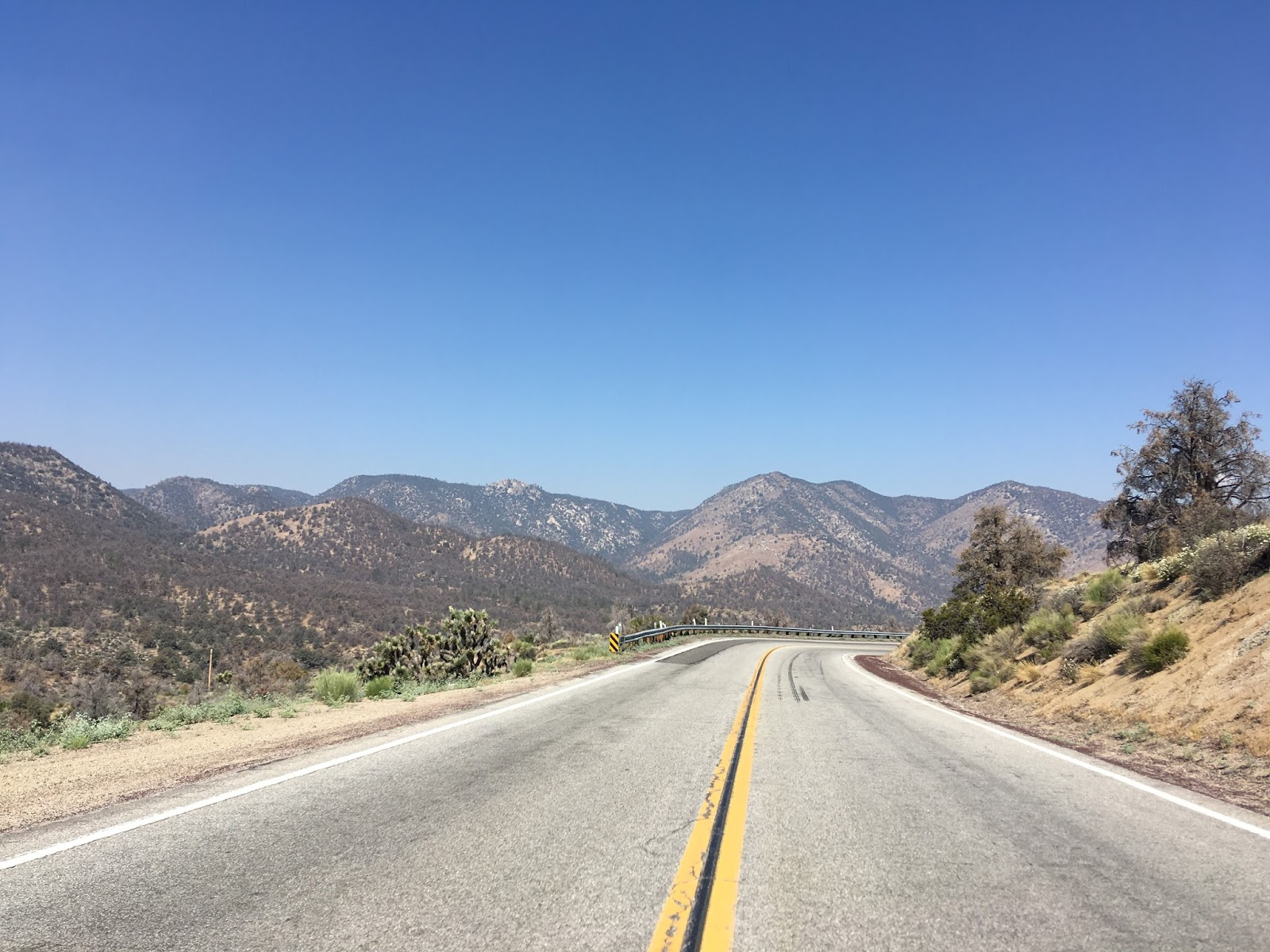 the kern river valley is very apparent descending walker pass the curve ahead isn t as daunting as the 20 mph advisory speed would suggest