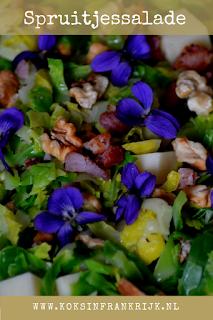 Spruitjessalade met eetbare viooltjes