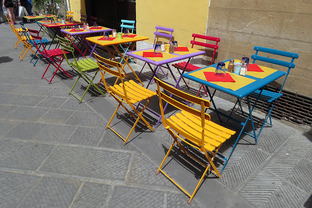 Chairs outside the Trattoria Cornelius, Via Faenza, Florence,