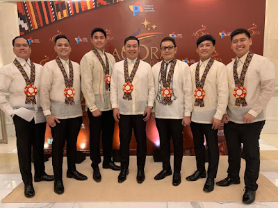 Seven guests wearing leis for visitors in Manila, Philippines