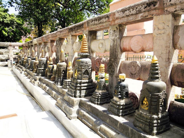 The boundary railings of the Mahabodhi Temple, Bodhgaya are replicas (made of cement) of the original stone railings which date back to the time of Ashoka (3rd century BCE) and are kept in the Bodhgaya Archaeological Museum.