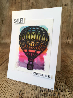 White greetings card showing a black die cut balloon sitting over a rainbow water coloured background made using the Up & Away Thinlits Dies by Stampin' Up!